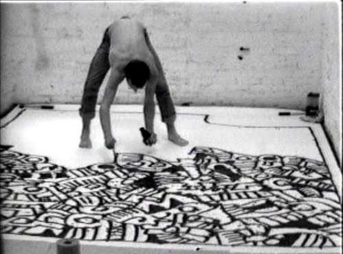 Performance artist Keith Haring painting himself into a corner - almost like me!